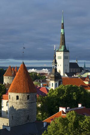 The old Oleviste Church and the defensive tower under a cloudy sky. Old Tallinn, Estonia