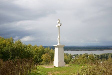 memorial cross: Memorial Cross in memory of the dead residents of Galich in the Time of Troubles (1609) on top of the mountain Baltschug, cloudy september day. Galich, Kostroma region