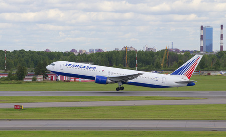 SAINT PETERSBURG, RUSSIA - JULY 27, 2015: Flying the Boeing 767-200ER (EI-RUZ) the airline Transaero Airlines. Pulkovo Airport