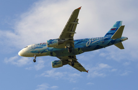 SAINT PETERSBURG, RUSSIA - JULY 24, 2015: Airbus A319-111 (VQ-BAS) of the airline Russia in the color of the football club Zenit on the background of cloudy sky Editorial