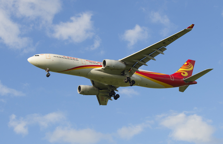 airbus: SAINT PETERSBURG, RUSSIA - JULY 24, 2015: The Airbus A330-343 airline Hainan Airlines before landing in Pulkovo airport