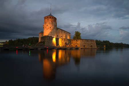 The medieval fortress in the town of Savonlinna on  August night. Finland