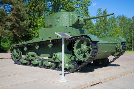 breakthrough: Tank T-26 at the diorama Breakthrough of the blockade of Leningrad on a sunny summer day. Leningrad region