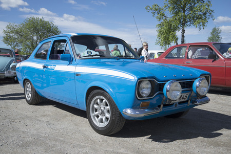 escort: KERIMYAKI, FINLAND - JUNE 06, 2015: Ford Escort the first generation in the sport version of Mexico 1600GT at the parade of vintage cars Editorial