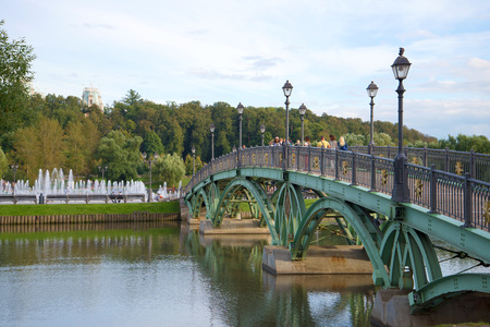 tsaritsyno: Openwork arch bridge in reserve Tsaritsyno, September cloudy day. Moscow Stock Photo