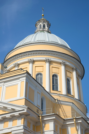 Dome of Trinity Cathedral of the Alexander Nevsky Lavra closeup on blue sky background. Saint Petersburg, Russia