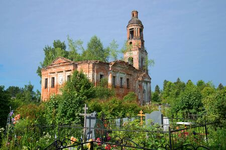 Ruins of the thrown Vozdvizhensky church at the old cemetery. Village of Shashkovo. Yaroslavl region, Russia Stock Photo