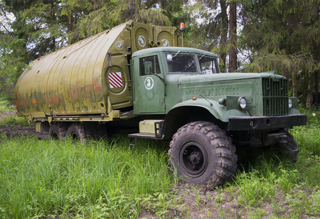 ponton: LENINGRAD REGION, RUSSIA - JULY 05, 2015: Military KrAZ-255B1 with a pontoon bridge Park PMP-M Editorial