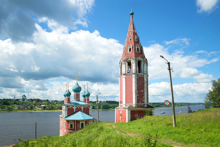Church of the icon of the mother of God of Kazan with a separate bell tower on the river Volga July afternoon. Tutayev, Russia