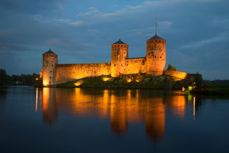 bastion: View of the towers of the Olavinlinna fortress in the August twilight. Savonlinna, Finland
