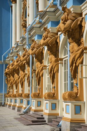 atlantes: SAINT PETERSBURG, RUSSIA - JULY 10, 2015: Sculptures of Atlantes supporting the Catherine Palace. Tsarskoye Selo Editorial