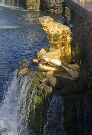 neptune: SAINT PETERSBURG, RUSSIA - JULY 03, 2015: A sculpture of Neptune sitting above the falling water. Peterhof