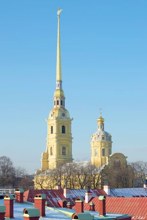 The spire of the Peter and Paul Cathedral in the background of blue sky. View from the Neva curtain. Saint-Petersburg, Russia Stock Photo
