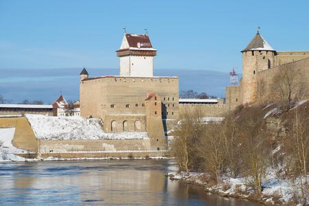 herman: LENINGRAD REGION, RUSSIA - MARCH 02, 2016: View of the Herman castle from the Russian side of the Narva river sunny March day. Estonia Editorial