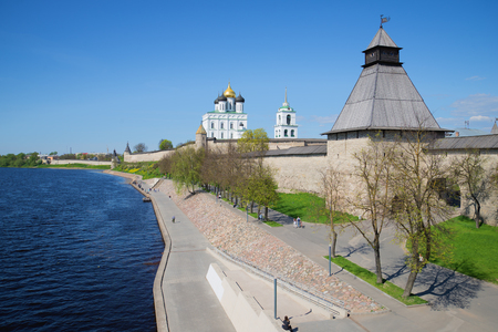 river view: Velikaya river embankment at walls of the Pskov Kremlin in the sunny May afternoon. Pskov, Russia