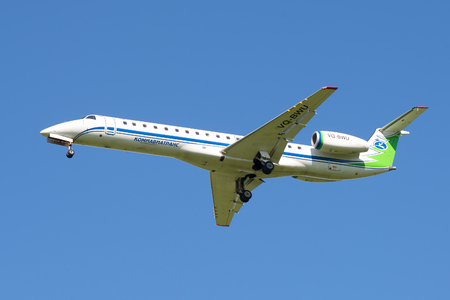 ST. PETERSBURG, RUSSIA - AUGUST 24, 2016: The Embraer ERJ-145LR plane (onboard VQ-BWU) Airline Komiaviatrans in the blue sky Editorial