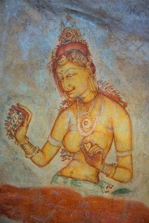 sigiriya: SIGIRIYA, SRI LANKA - MARCH 16, 2015: Ancient fresco depicting the Royal concubines on the wall of Sigiriya rock