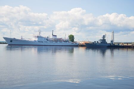 oceanographic: ST. PETERSBURG, RUSSIA - JULY 18, 2015: The oceanographic research vessel Admiral Vladimirskiy and anti-submarine corvette Urengoy in the Petrovsky harbor in the cloudy July afternoon. Kronstadt Editorial
