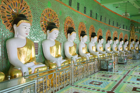 min: SAGAING, MYANMAR - DECEMBER 20, 2016: Gallery of statues of sitting Buddhas cave pagoda U Min Thonze Temple Editorial