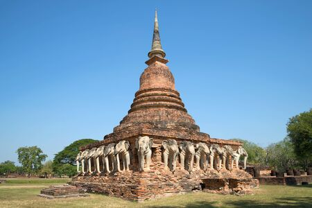 to maintain: Chedi ancient Buddhist temple of Wat Sorasak in Sukhothai. Thailand