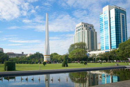 stele: View of Democracy Monument in the sunny day. Yangon, Myanmar