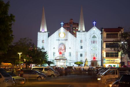 immanuel: YANGON, MYANMAR - DECEMBER 18, 2016: Baptist Church of Immanuel in the Christmas illuminations in the evening twilight Editorial