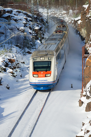 allegro: VYBORG, RUSSIA - FEBRUARY 24, 2017: A high-speed electric train Allegro on a route St. Petersburg - Helsinki in the sunny February day