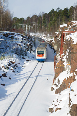 allegro: VYBORG, RUSSIA - FEBRUARY 24, 2017: High-speed train Allegro on the route St. Petersburg - Helsinki goes for turning a sunny winter day