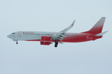 SAINT PETERSBURG, RUSSIA - FEBRUARY 25, 2017: Boeing 737-8LJ Krasnodar (VQ-BVU) of airline Rossiya - Russian Airlines in overcast the sky before landing in Pulkovo airport
