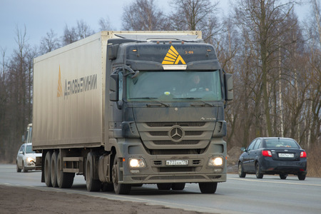 expeditionary: LENINGRAD REGION, RUSSIA - MARCH 09, 2017: The auto train of the transportation expeditionary company Business Lines with the drive truck Mercedes Aktros 1841 on the roud M-10 close up