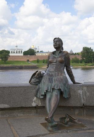 Statue of resting girl on the background of the Kremlin. Veliky Novgorod Stock Photo