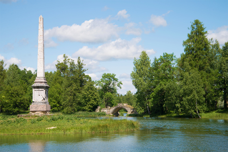 leningrad: A view of the Chesme obelisk and the Humped bridge on the Gatchina palace park. Leningrad region, Russia Editorial