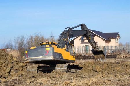 LENINGRAD REGION, RUSSIA - MARCH 09, 2017: Crawler excavator digs a trench