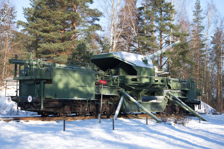 conveyor rail: LENINGRAD REGION, RUSSIA - FEBRUARY 08, 2017: A 180-mm railway artillery cannon TM-1-180 in fighting situation in the February sunny day. Fort Krasnaya Gorka (Alexeevsky)