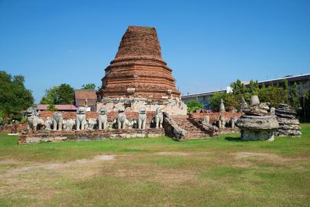 The ruined stupa of the Buddhist monastery of Wat Tummickarat on a sunny afternoon. Ayutthaya, Thailand