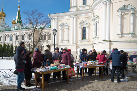sanctification: SAINT PETERSBURG, RUSSIA - APRIL 15, 2017: Parishioners in anticipation of the consecration of Easter food in Voskresensky Novodevichy convent
