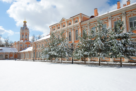 Snowy April morning in the Alexander Nevsky Lavra. Views of the Metropolitan housing and the South-West tower. Saint Petersburg, Russia