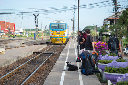 AYUTTHA, THAILAND - JANUARY 02, 2017: European backpackers wait for the train to arrive on the railway station Editorial