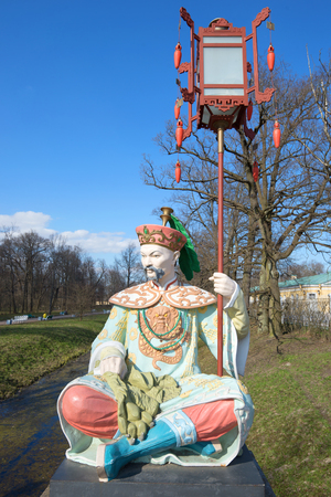 st petersburg: ST PETERSBURG, RUSSIA - MAY 04, 2017: Sculpture of a chinese with a lantern on the Great Chinese Bridge on a sunny May day. Tsarskoe Selo Editorial