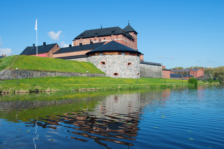 The fortress of the city of Hameenlina on the bank of the Vanayavesi lake in the sunny June afternoon. Finland Sajtókép