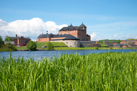 Sunny June day on the Vanajavesi lake. View of the old fortress of Hameenlinna, Finland 報道画像
