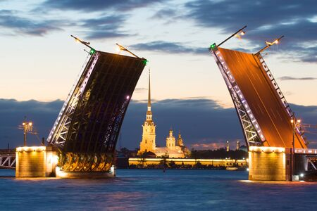 Peter and Paul Cathedral in the alignment of the diluted Palace Bridge on a white night. Saint-Petersburg, Russia