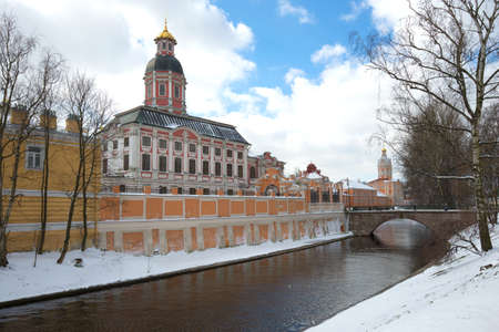 A cloudy April day on the Monastyrka river. View of the Annunciation Church of the Alexander Nevsky Lavra. St. Petersburg, Russia