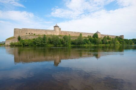 Ivangorod fortress on the Narva river on a cloudy August day. Russia