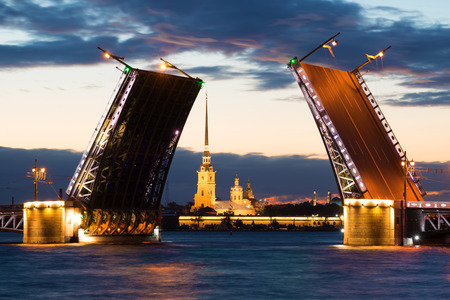 st petersburg: Divorced Palace Bridge and Peter and Paul Cathedral on a cloudy June night. St. Petersburg Stock Photo