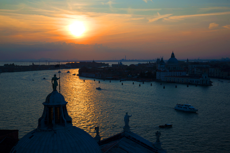 Sunset over Venice. View from the bell tower of the Cathedral of San Giorgio Maggiore. Italy