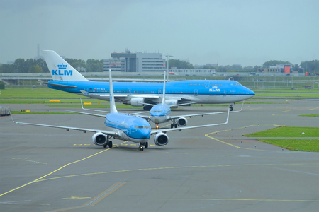 AMSTERDAM, NETHERLANDS - SEPTEMBER 30, 2017: Three planes of KLM airline on the Schiphol Airport airfield Editorial