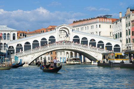 VENICE, ITALY - SEPTEMBER 26, 2017: A sunny day at the Rialto Bridge