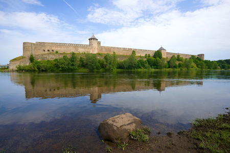Ancient Ivangorod fortress on the Narva River in the August day. Ivangorod, Russia Stock Photo