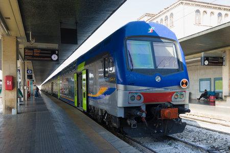 VENICE, ITALY - SEPTEMBER 28, 2017: Passenger two-story train Vivalto 33 at the platform of Santa Lucia Railway Station